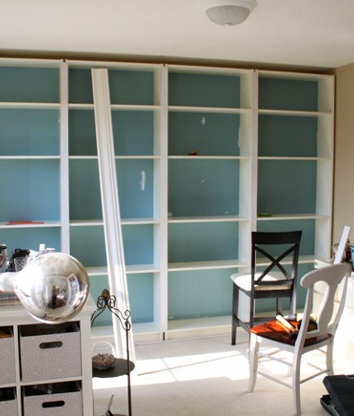 We slid the four bookcases into place and surrounded it with trim to build it in.