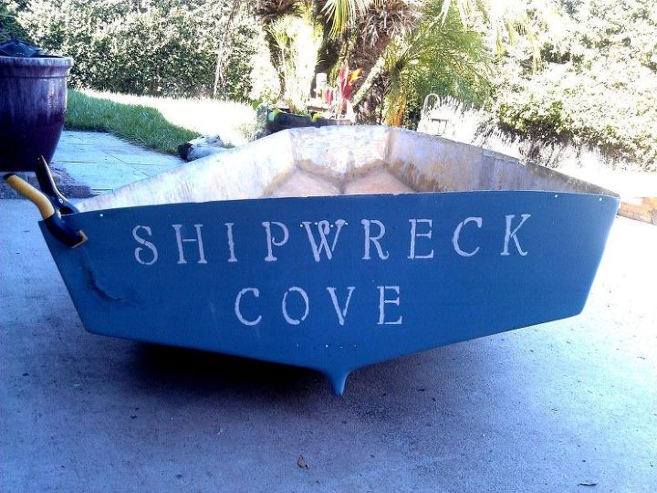 I repaired the crack with some epoxy and silicone and gave the boat a new name.  I wasn't too concerned about the name being perfectly centered as it wasn't going to be very visable in it's new home.