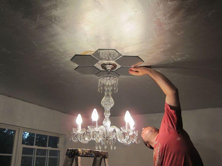 DIY mirrored ceiling medallion application.