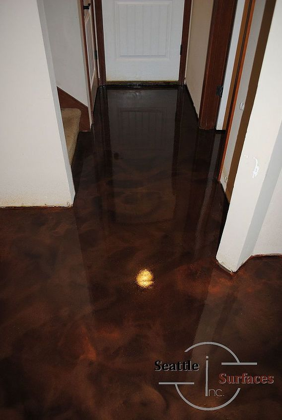 A designer metallic epoxy basement floor.