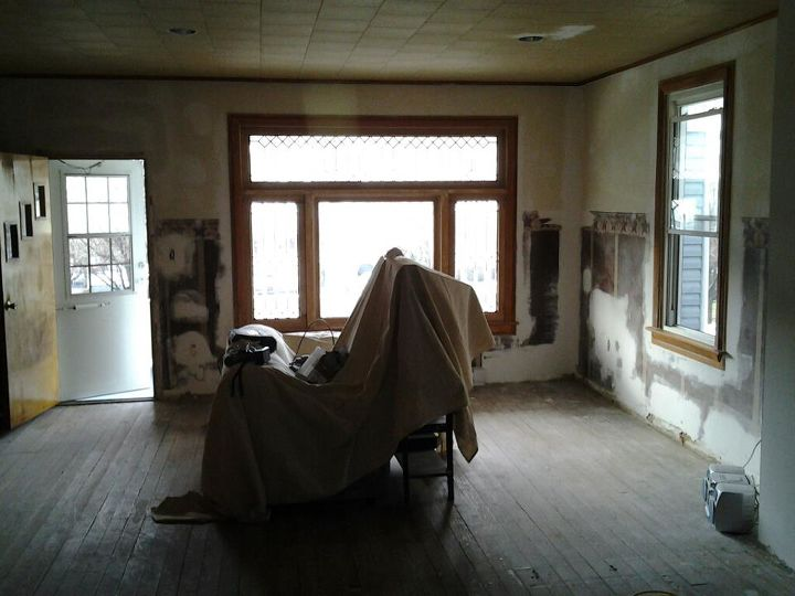 """Before  # 1 (Angle -1) """"demo had been done, electrical and insulation with first stage of plaster repair ( New front door had not yet been installed)"""