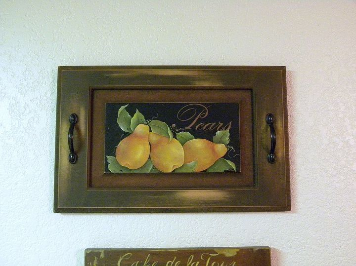cabinet door serving tray by granart, crafts, painting, repurposing upcycling, 2 coats of spice brown acrylic paint on the outside frame Add a touch of red to that brown paint and add 2 coats to the mat area of the door Add 2 coats of black for the back ground and paint a few pears and the word Pears