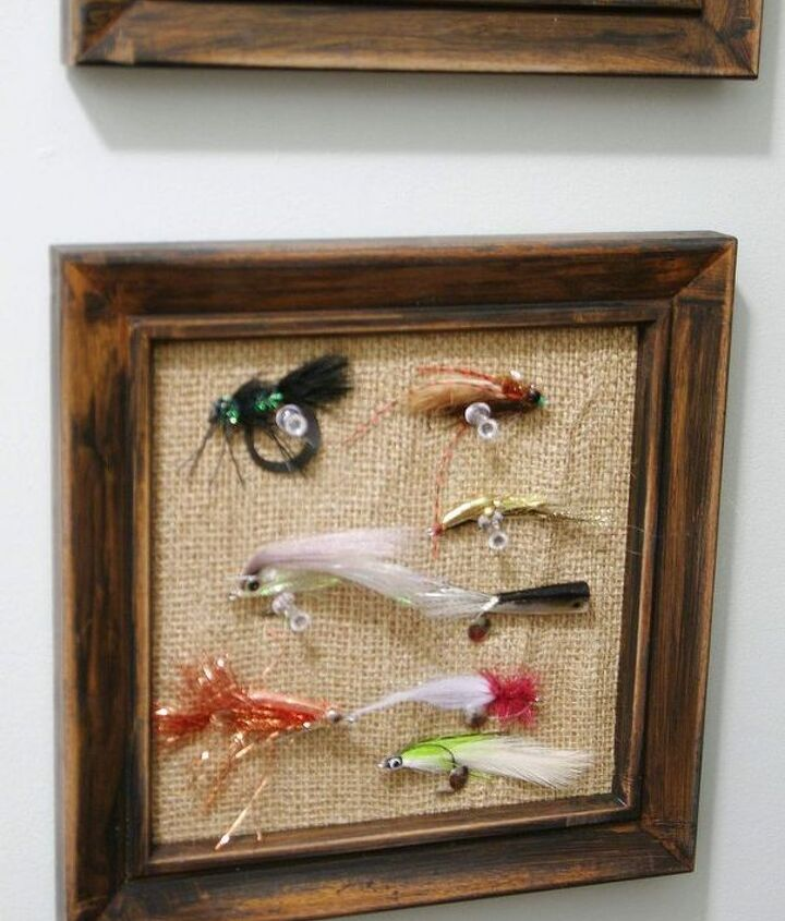 Flies are pinned to framed burlap bulletin boards for easy access and display.