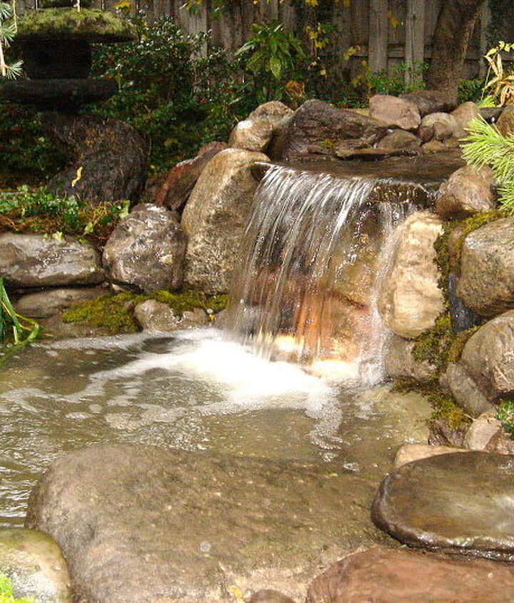 New Waterfalls Replaced, Repaired, Re-Installed, Refurbished Fixed, Remodeled, Restored with LED Lighting and Aquascape Filtration System for this Rochester NY Pond. Acorn Landsdcaping, Certified Aquascape Contractor of Rochester NY
