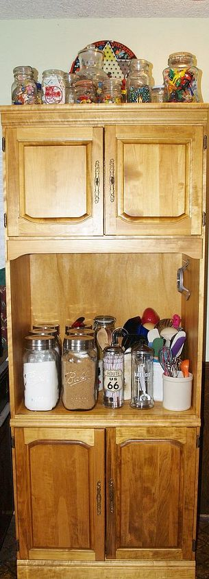Recently I got these really cool mason jars that I am using as canisters!  My big spatulas etc... are in crocks I have collected over the years.  We took the lazy Susan out and made the table with some arbor wood.
