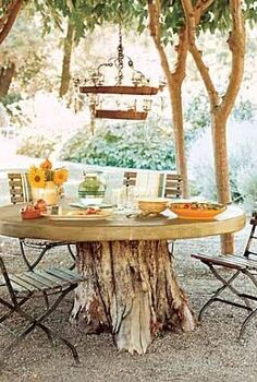 top 10 easy backyard ideas for entertaining, gardening, landscape, outdoor living, Repurpose your tree stumps Make an outdoor table by adding a tabletop to one of your tree stumps You can also transform old trunks into plant pots Just fill with soil plant with flowers and voila You ve recycled your tree stumps