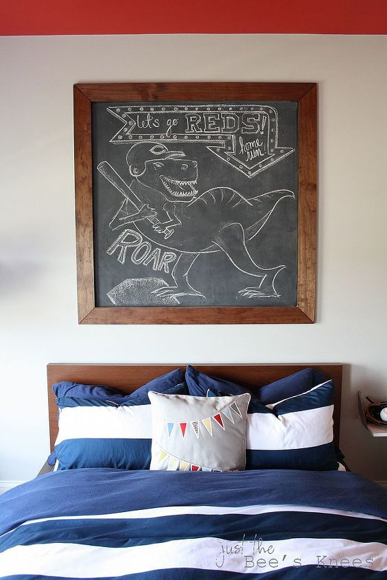 A framed chalkboard wall is the perfect art installation for the large space above his bed.