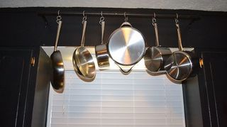 diy hanging pot rack, storage ideas, I mounted the rack above the sink in front of the window