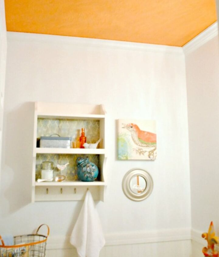 Adding color to a ceiling is an unexpected and fun way to incorporate it into an otherwise neutral color palette.