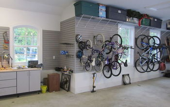 garage organization for a family of 10, garages, organizing, shelving ideas, storage ideas, Bikes are hung with slatwall bicycle hooks and storage containers rest on shelves high above