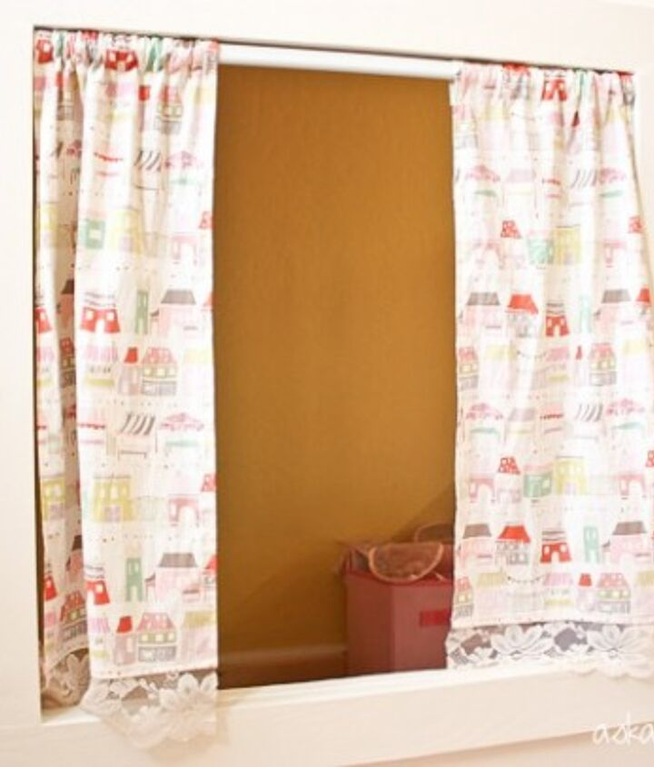 Cafe curtains I made for the playhouse windows.  I also made coordinating curtains for her bedroom.