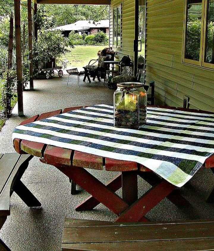 A view of my studio's open back porch. This space is decorated with a table and four stool left by the previous owners and roadside rescues.