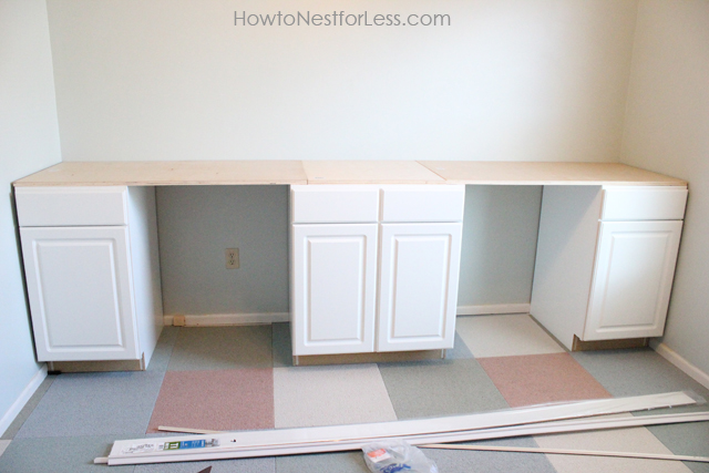 Building the desk with white cabinets