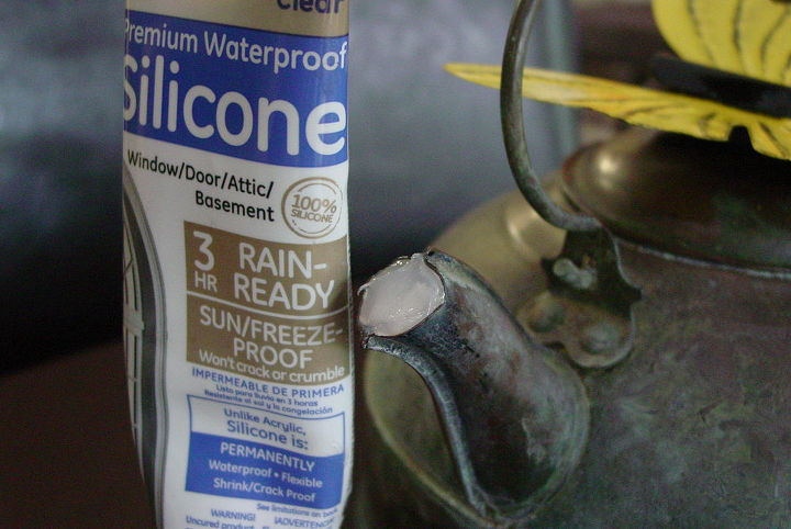 I stuffed the spout opening with a wad of newspaper and inserted the waterproof silicon to keep the rain out.