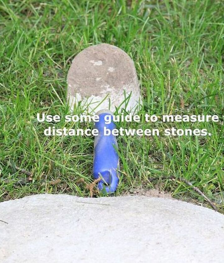 Use something as a guide to measure equal distance between stones. Here I used a trowel.