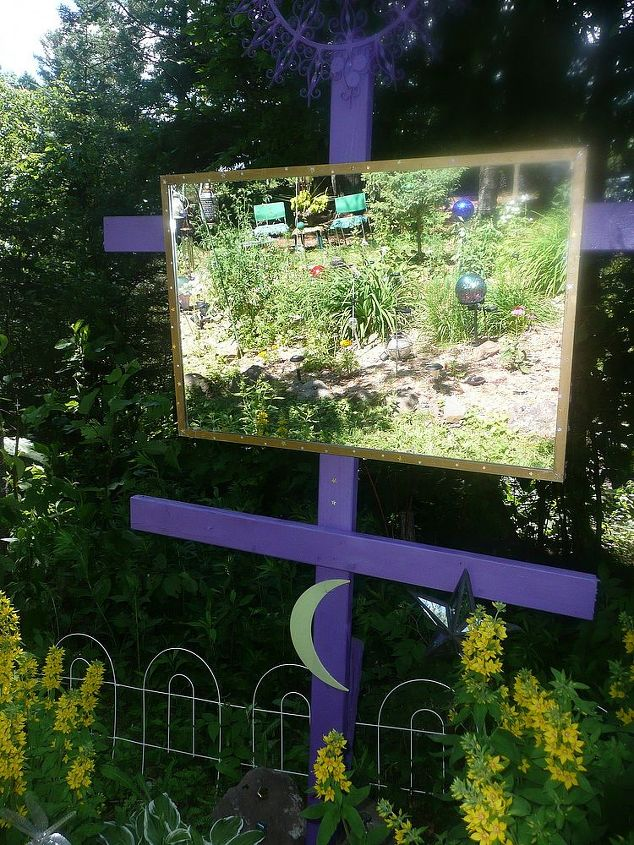 I use a lot of mirrors in my gardens. They reflect the solar lights at night and the gardens by day. I also silicone mirror pieces on my trees to create the same effect.