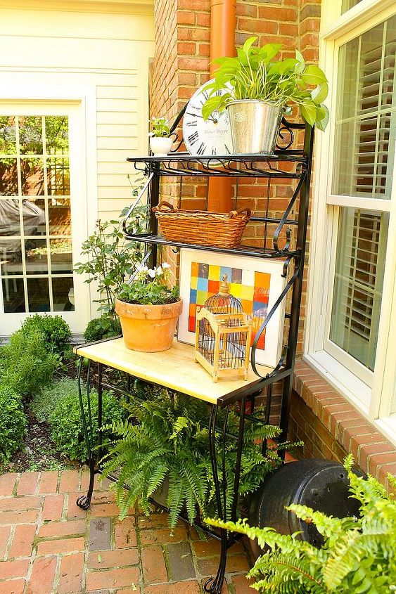 It became an instant potting bench/bar/server and sits in an area beside the herb garden.