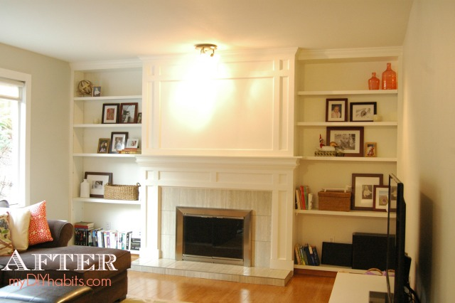 AFTER: We drywalled over the brick, added custom woodwork, a new mantel, tile surround and crown molding