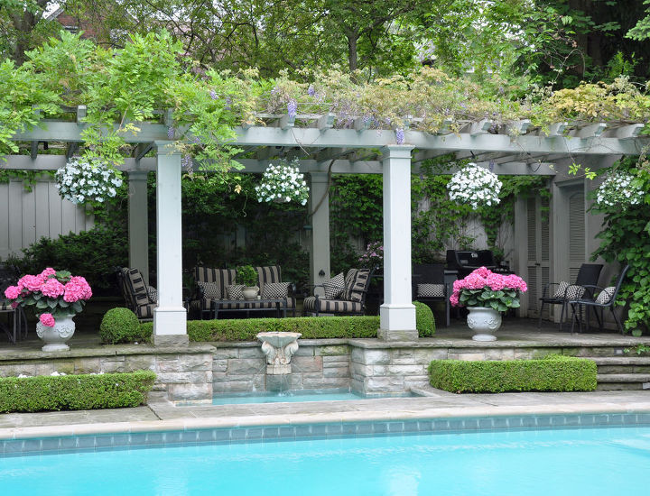 Set above the pool is a large, vine covered pergola.   Now, wouldn't this be the perfect spot to relax on a lazy summer afternoon?
