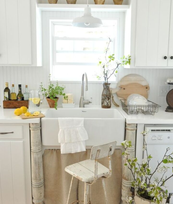 Farmhouse kitchen with white painted countertops
