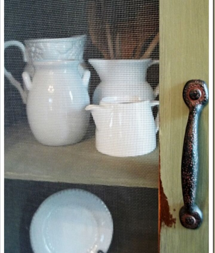 We changed up the hardware to old rustic, rusty looking handles, (although very new, bought from Lowes)