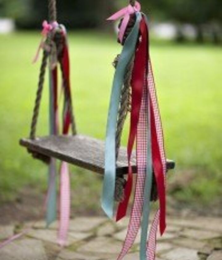 We have the perfect tree for an outdoor swing! With a piece of sanded (and possibly painted) upcycled wood, rope and ribbon, all of the kids can enjoy this peaceful and beautiful swing in the yard.
