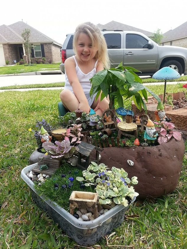 Lexi proudly displaying her new Gnome Garden