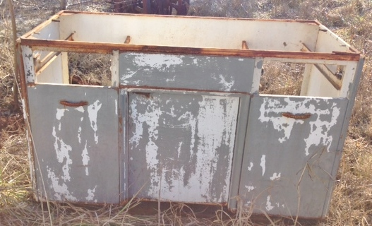 The cabinet we found in a friend's pasture.
