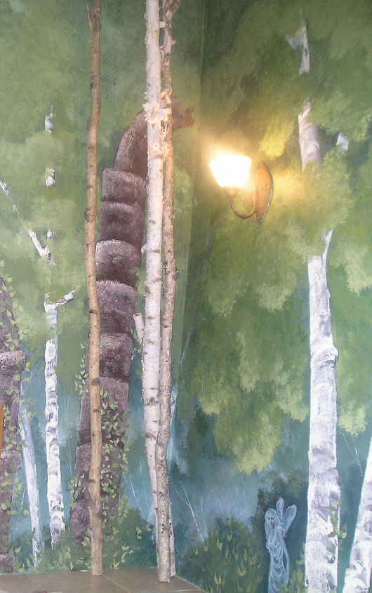 The textured trees and column detail was sculptured out of Wood Frosting. Then the mural was painted. We added white birch trees from hubbies Montana home for depth and interest.