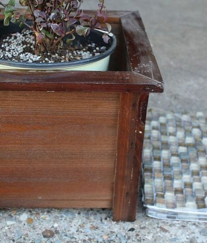 We started with a cheap, wooden planter from the clearance section. Choose something with smooth sides. It took two square feet of tiles to cover this planter.