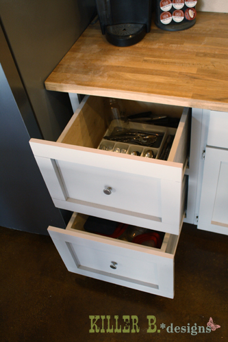 Deep double drawers, I've since added a divider to the top drawer to store my utensils upright for easy access