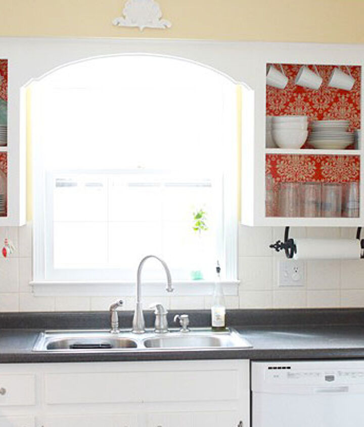 Opening the cabinets on both sides of the window gives some symmetry.