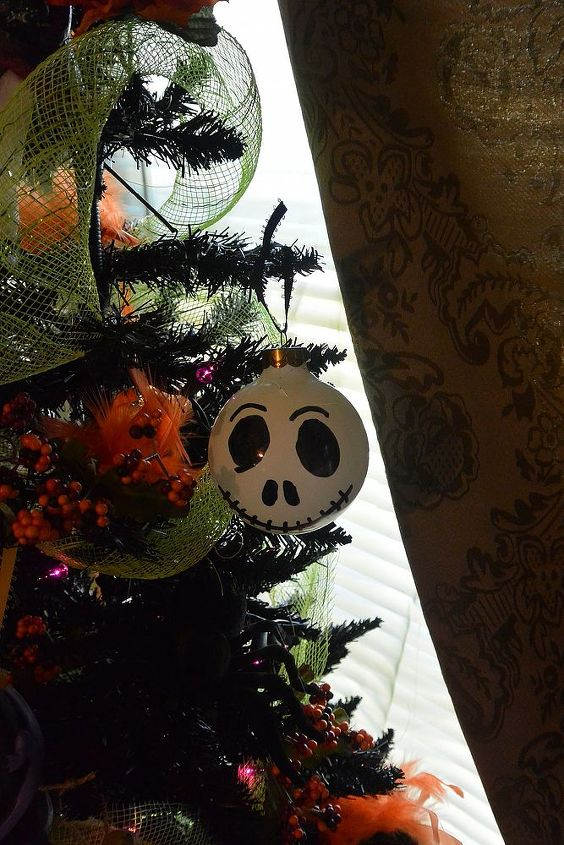 A white ornament I had I drew the face on to make it into Jack Skellington.