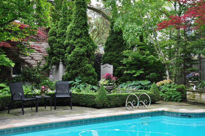 The plantings help to soften the hard edge of the pavers around the pool.