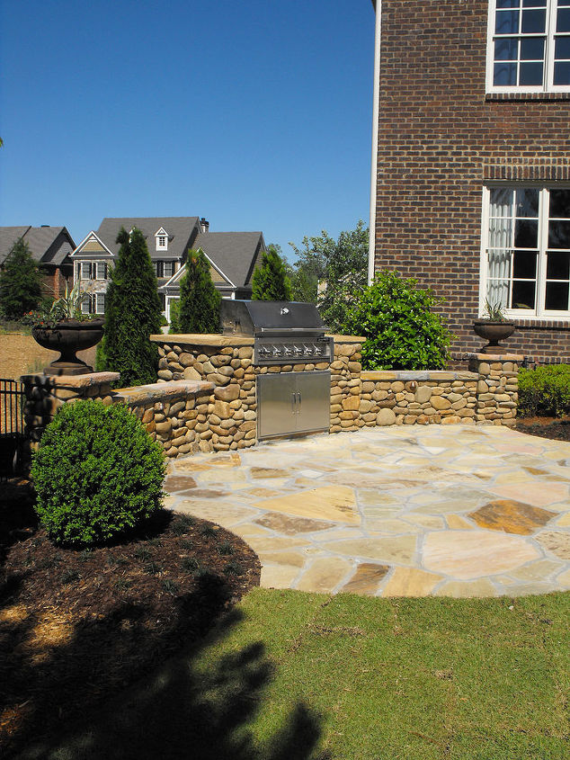 we used river rock which is normally used in creek beds on this outdoor kitchen, outdoor living, patio