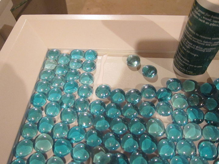 Glass gem covered table. get the details here: http://www.madiganmade.com/2012/06/diy-furniture-update-how-to-tile-table.html
