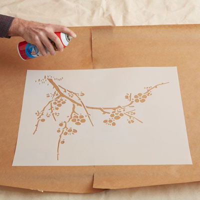 Start the pattern on the lower left and work from the left side to the right side. In a ventilated area, lightly spray the back of a stencil with repositionable adhesive, let dry for a few seconds, and press the stencil in place.
