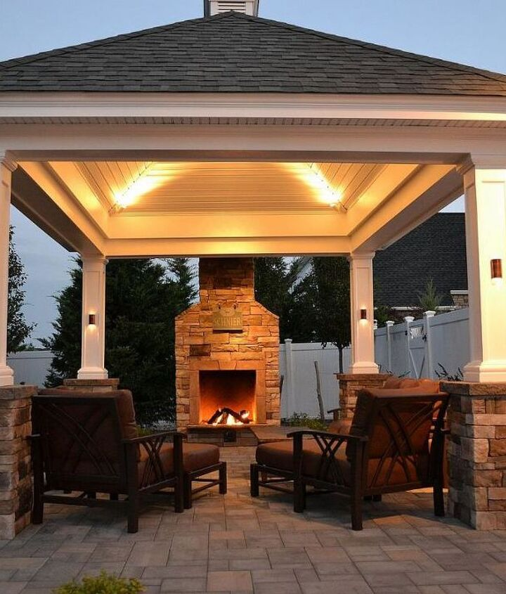 At the edge of a patio, beside a lovely shingle-roof gazebo/pergola, this fireplace not only offers warmth in autumn and winter months but it creates the perfect ambience for conversation.  www.longislandhottub.com