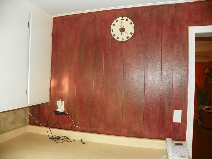 This wall all I did was remove the tile from under the cabinet and then I painted it with 3 different colors using a dry brush method to make it look like old Red Barn wood