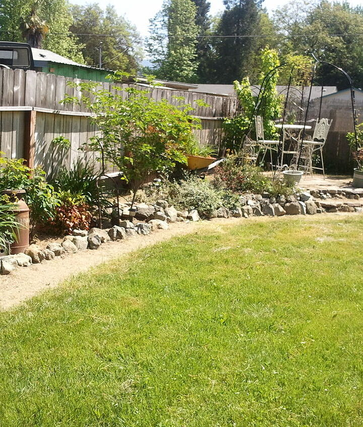 this is older photo but the shrub looking thing to the left before the arbor is one of my dogwood trees