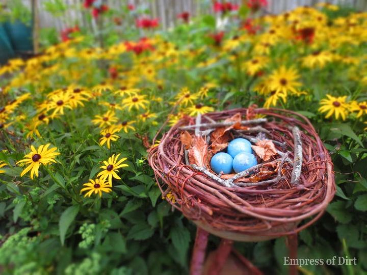Rocks or painted decorative eggs give the finishing touch. http://www.empressofdirt.net/gardenartbirdnest/
