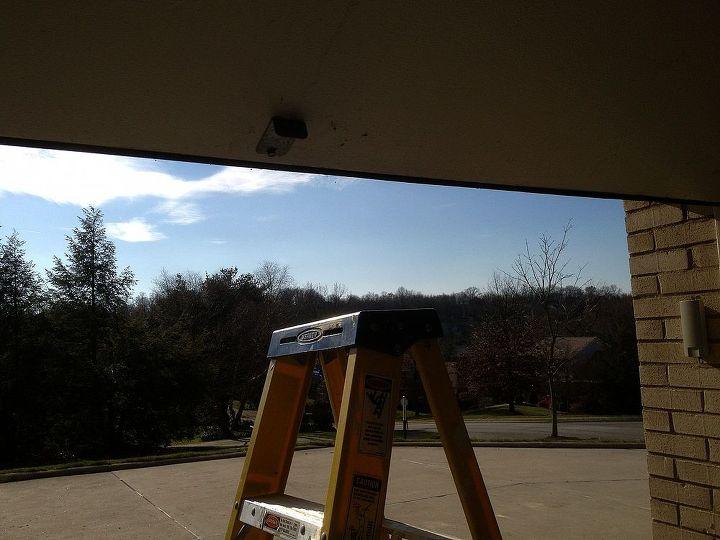 Put a ladder under the garage door