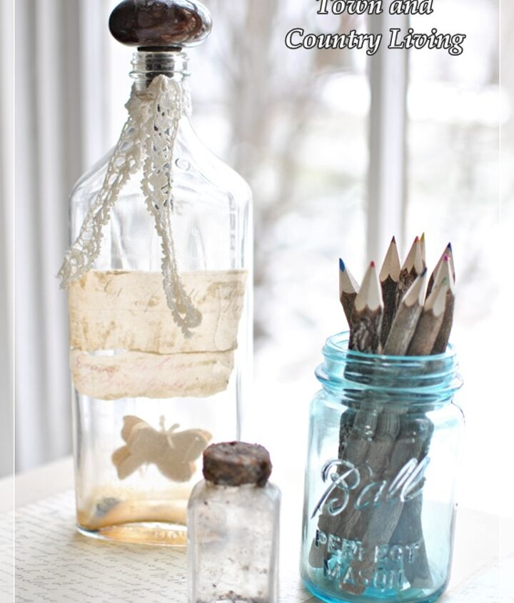 A few old bottles adorn the desk, one with twig-type pencils.