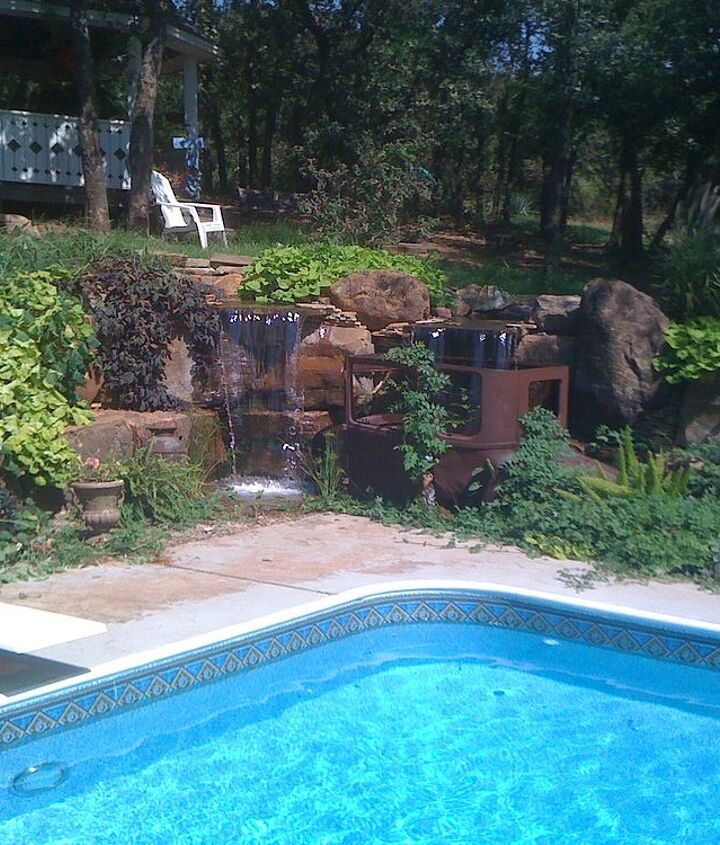 This pondless waterfall is a great backdrop for the swimming pool.