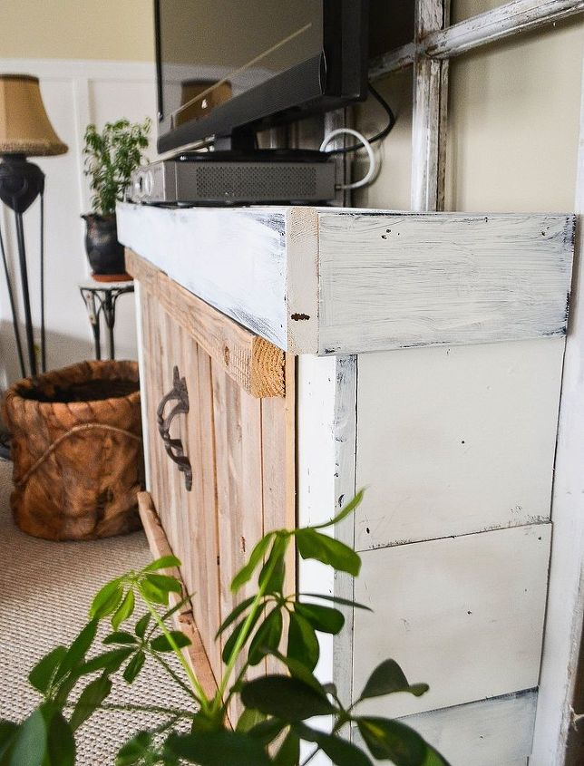 The doors and handles are just for looks. The piece underneath can be seen http://downtoearthstyle.blogspot.com/2012/09/new-old-foyer-table.html