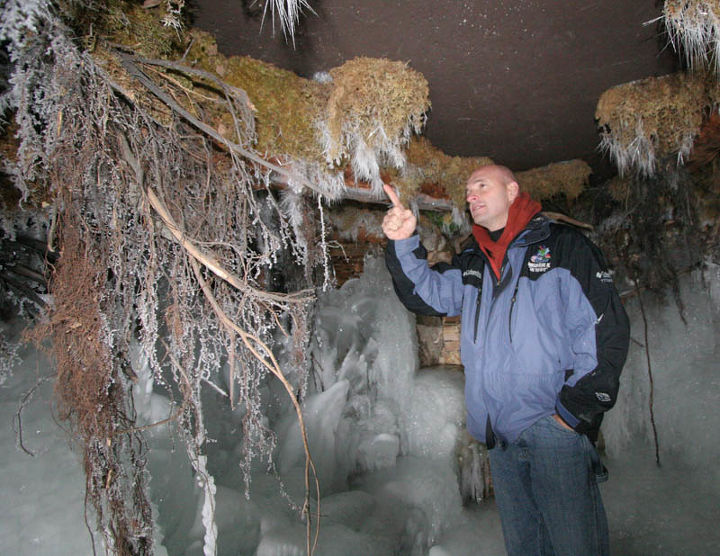 Ed Beaulieu points out ice needles inside the grotto.
