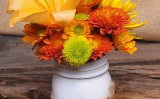 budget friendly fall decor, crafts, mason jars, outdoor living, seasonal holiday decor, wreaths, Everyone has mason jars burlap and spray paint laying around now a days Might as well combine them with the colorful flowers in the garden for fall inspired centerpieces when guests are coming by