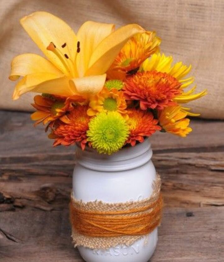 Everyone has mason jars, burlap and spray paint laying around now a days. Might as well combine them with the colorful flowers in the garden for fall inspired centerpieces when guests are coming by.