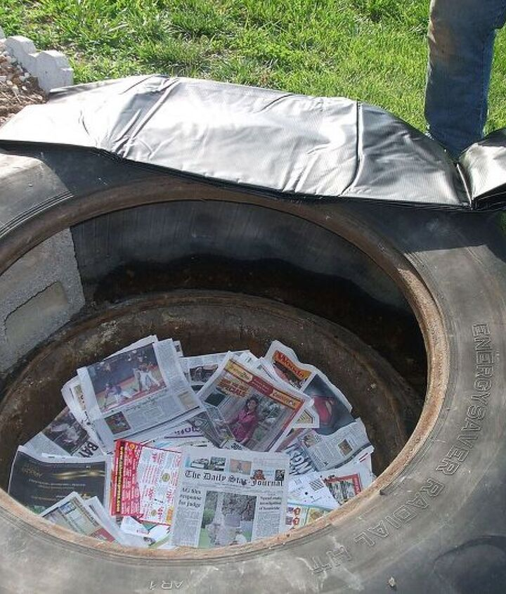 We laid a bunch of newspapers into the bottom so rocks wouldn't poke holes into the liner.