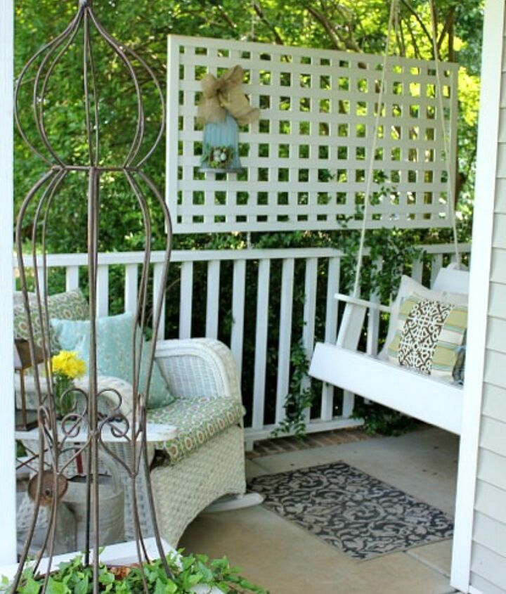 I have created a little conversation area in this small corner of my front porch.